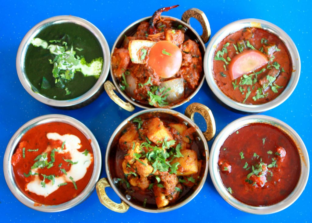 (From top left clockwise) Palak Paneer, Chicken Do Piyaza, ???, Mutton Rogan Josh, Aloo Gobi, Butter Chicken