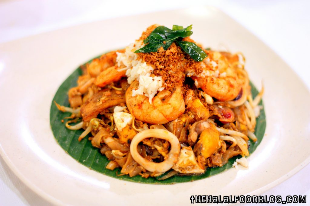 Premium Crab Meat and Salted Egg Fried Kway Teow ($15.95)